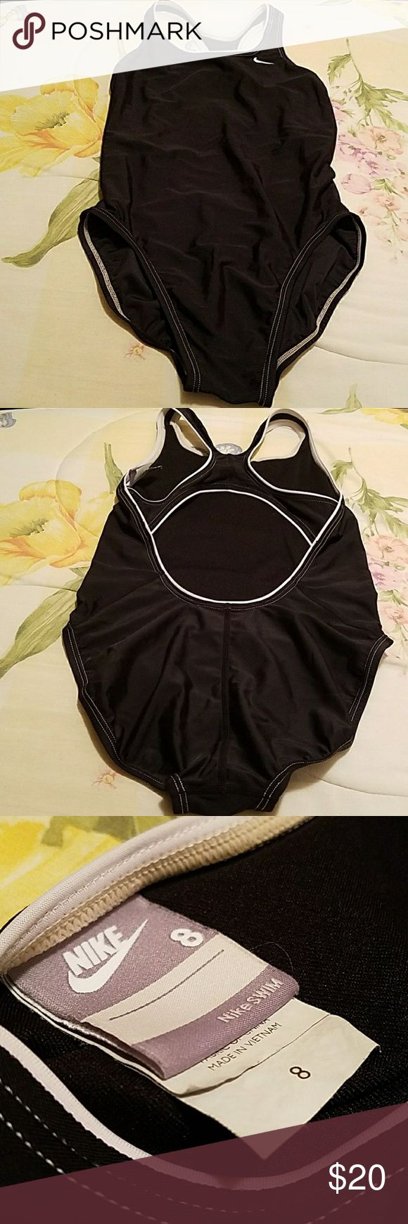 Nike Power Back One Piece Swimsuit Black Nike one piece swimsuit with white trim details. Perfect for swim practice or a more conservative look.  Girls size 8 but can fit a petite woman. Measurements in inches:  Bust: 29 1/2 Waist: 22 Hip: 32 1/4 Torso: 56 1/4  81% nylon, 19% spandex Lining: 100% polyester  OFFERS ARE WELCOME! Nike Swim One Piece