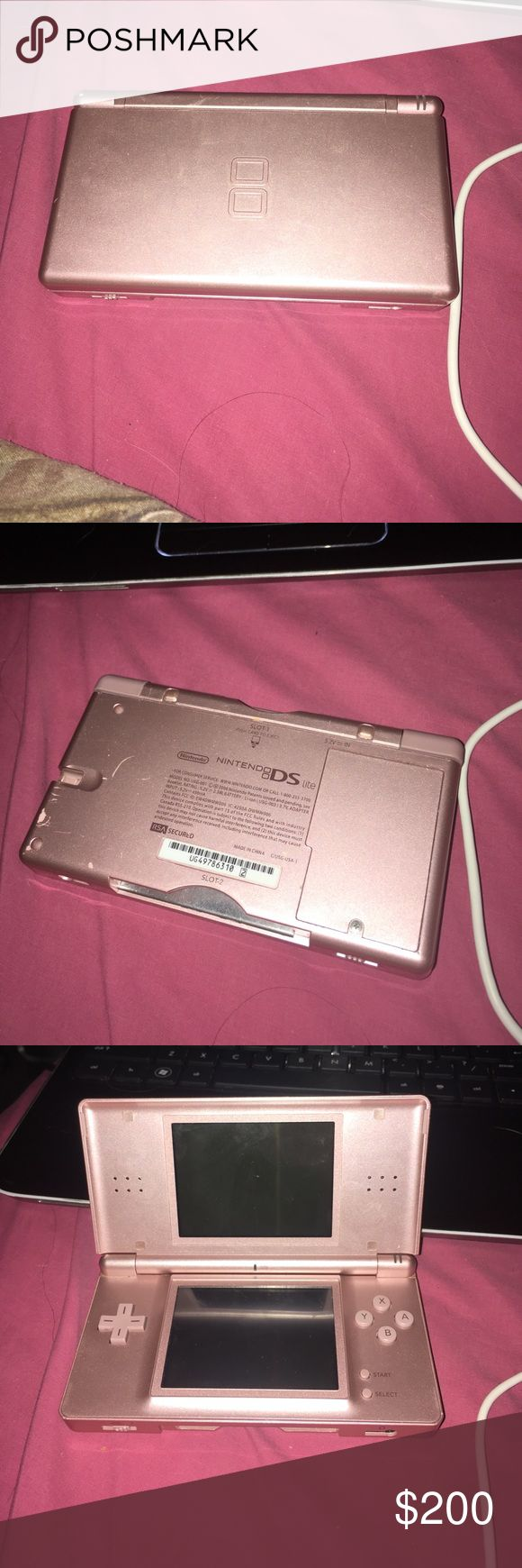 Nitendo DS lite Used Nintendo DS lite comes with charger and a couple games it does not have the pen the games come with the original case Other