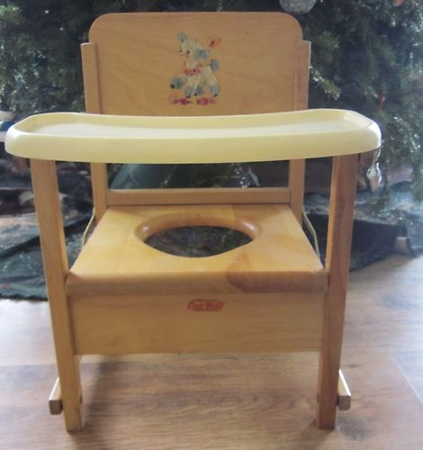 """Wood potty chair.  It had a slide in yellow plastic bowl to catch the """"number 2 and number 1"""".  You could have cheerios while your mother made you sit there."""