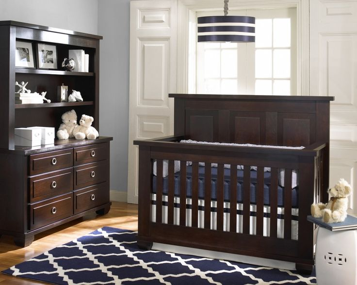 Love this nursery! The rug, the light fixture, the colors.  Traditional yet chic. Be sure to remove the pillows from the crib when baby is sleeping.