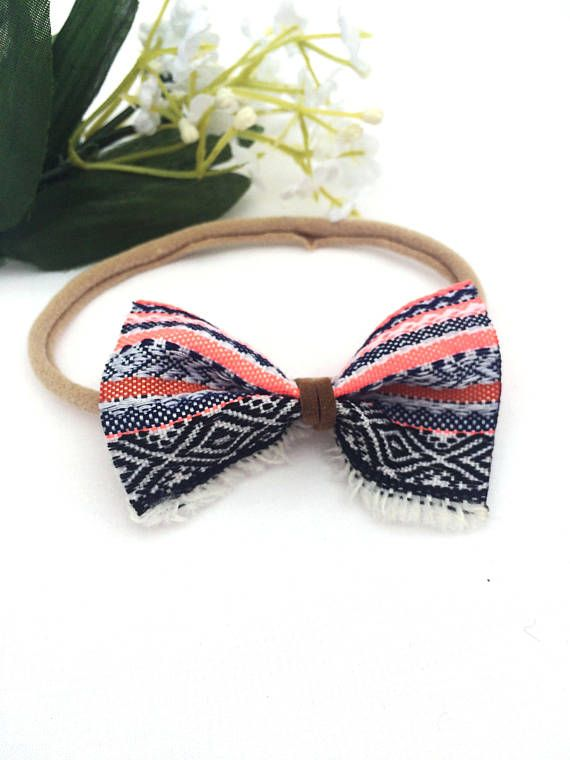 These handmade ribbon bows are the perfect accessory for babies and children all year round. The fluorescent pink paired with the black, navy, white and brown of this Betty Bow is the perfect addition to your boho babes outfit , while the soft nylon is super stretchy and will not leave marks on delicate baby skin.  These bows are approximately 7cm x 4.5cm The headband will stretch to fit up to an older child.  Product Safety All young children should never be left unattended or left to sleep…