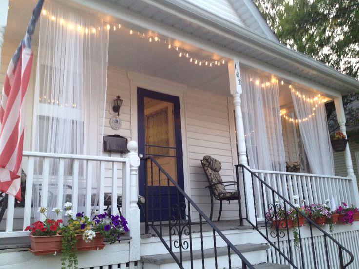 Front porch curtains. Love these curtains, this looks alot like my front porch. Love the lights, very soft.
