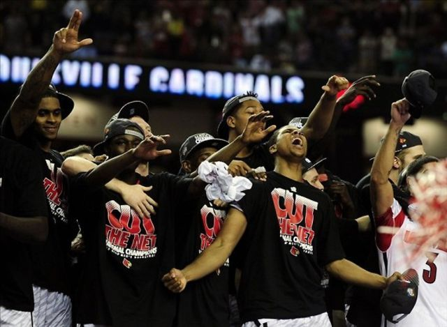 "Louisville Cardinals win the 2013 national title over the Michigan Wolverines led by Trey Burke.  This video celebrates that win, and the previous two titles.  Narrated by ""the voice of the cards"" himself, Paul Rogers.    Paul Rogers clips courtesy of nelligan sports marketing."