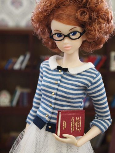 "I would like to look as pretty as this librarian doll. How adorable! Found at ""Libraries in Pop Culture"" -- interesting blog idea, bee-tee-dubs..."