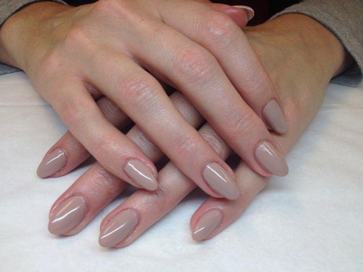 Stiletto style with beige gel polish
