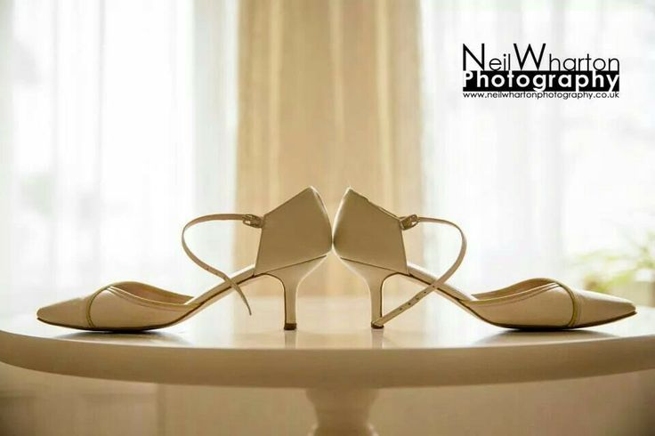 Shoes and hanging dress getting ready wedding photography Dorset wedding details