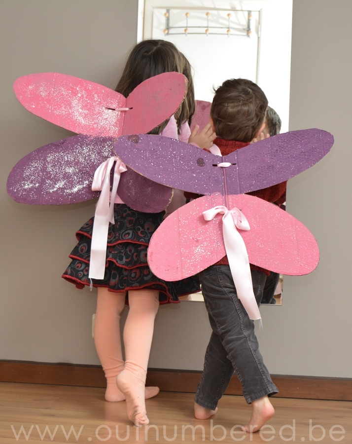 The kids made their own cardboard fairy wings. So much fun!