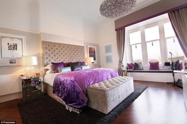Elegant: One of the bedrooms in the property has been decorated with a cerise and beige ve...