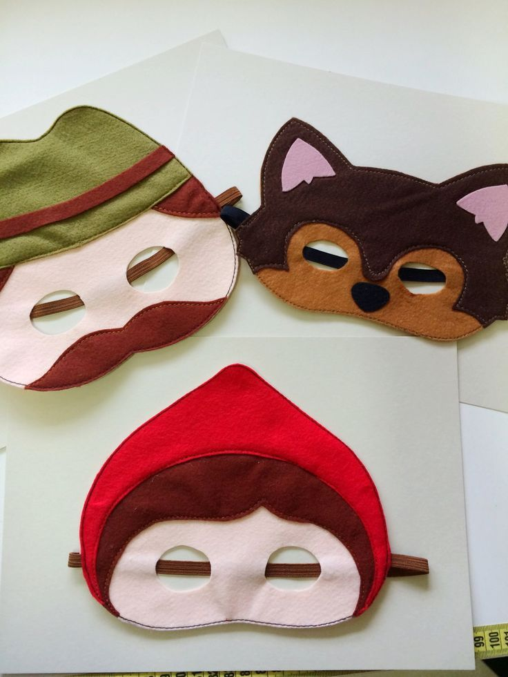 Little red riding hood masks.  Red riding hood mask, wolf mask and woodcutter mask.