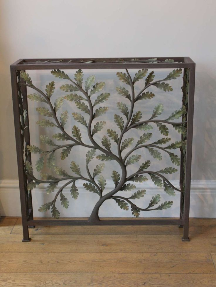 A custom made radiator cover based on the oak leaf design.