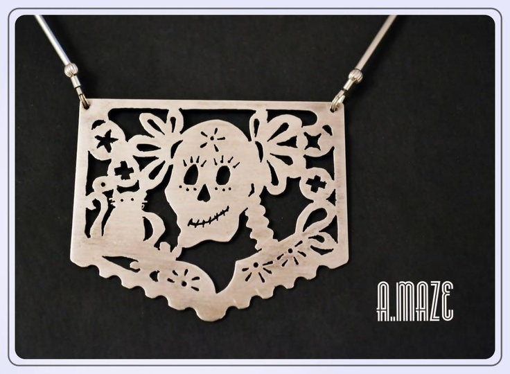 A folky statement necklace papel picado de dia de muertos, in Sterling Silver, hand-sawn.