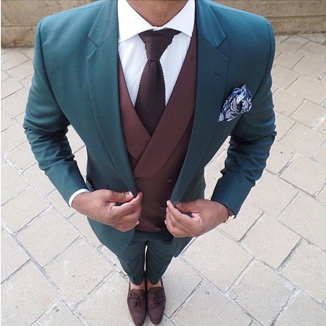 Great color scheme. Especially the pocket square. I don't like knit ties too much in formal outfits though.