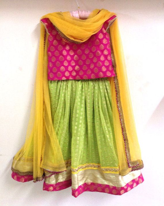 Girls brocade and chiffon lehenga in pink and lime green with yellow highlights
