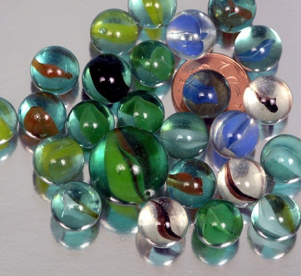 Marbles  I used give my Dad the prettiest catseye one.  I'd put it in his pocket or shoe.  When they opened his safe deposit box at the bank, after he died; there they were.. all of them
