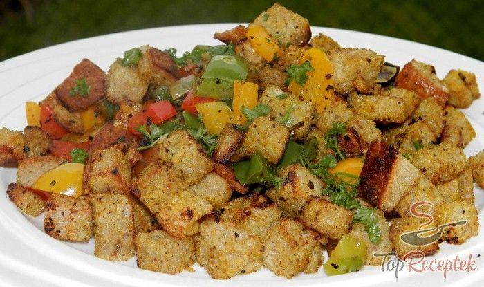 A maradék, öreg kenyér felhasználásának egy remek módja. A migas – spanyol szegények eledele a pirított kenyeret, a szalonnát és a zöldségeket ötvözi, ami kellő fűszerezéssel könnyű, gyors, mégis finom és laktató ebéd vagy vacsora lehet. Hogy színes legyen, piros, zöld és sárga paprikát használok. A recept tökéletesen műküdik maradék fehér kenyérrel. Ezt csak a serpenyőben vagy tepsiben jól megpirítom, majd összekeverem a zöldséges keverékkel.