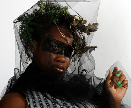 Lakisha A. Beauford designed and modeled an Atlanta tornado costume using 8 yards of fabric, a zipper, tulle and some plastic leaves.