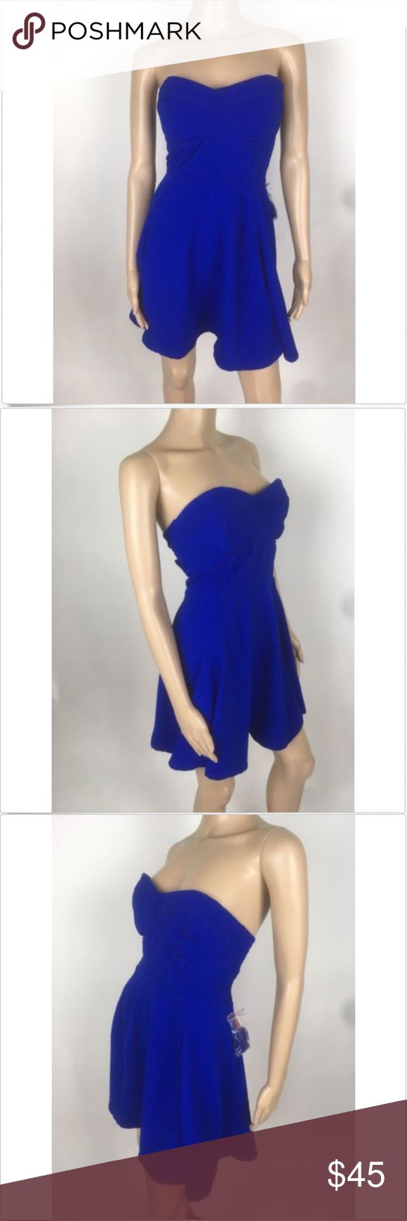 """NWOT Minkpink Blue Strapless Empire Waist Dress Minkpink new without tags women's blue strapless or adjustable spaghetti strap (removable) Stretch empire waist mini dress sz large Measurements laying flat Armpit to Armpit 17"""" Waist  17"""" Length 26"""" MINKPINK Dresses Mini"""