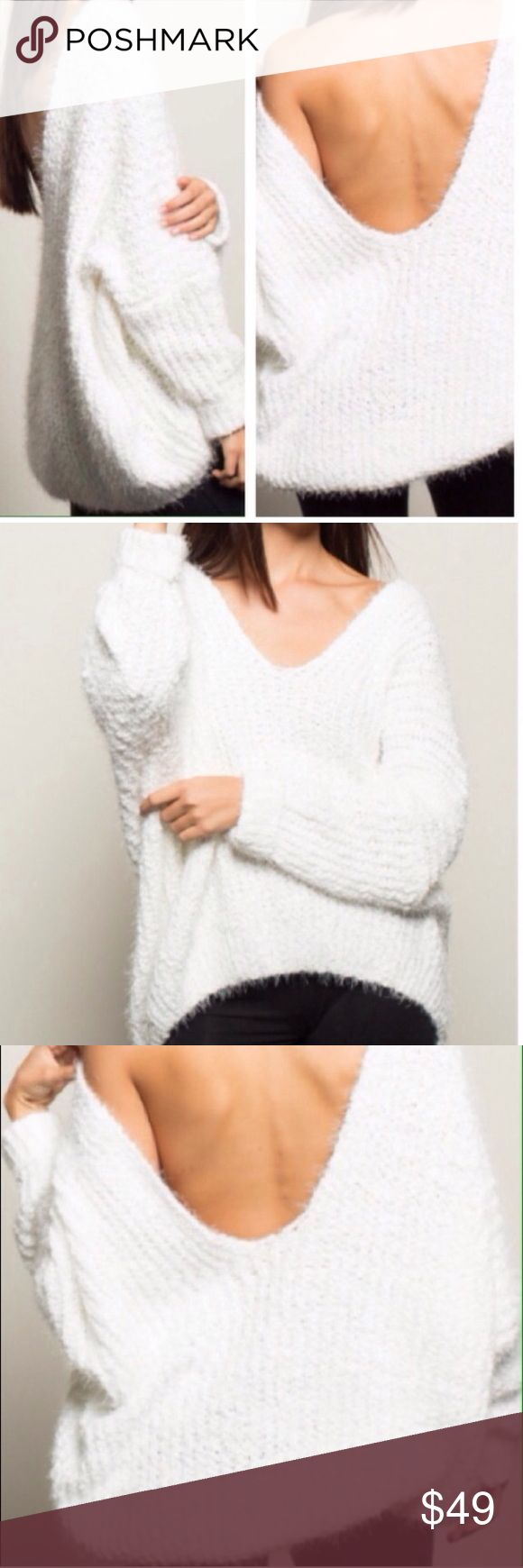 """NWT Winter White Oversized Open Back Sweater NWT.  Amazingly versatile eyelash knit sweater.  It can be worn as an open back Hi-low, front deep v-neck, or as a double v-neck.  Each way looks sexy cool with a strappy bra.  Oversized, super soft, drop shoulder.  70% Cotton 30% Acrylic. Approx measurements laying flat: chest 31"""", length 22"""". Extra pics at bottom of my closet.  NO TRADES❗️❗️❗️ Sweaters"""