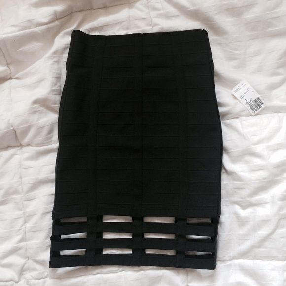 Forever 21 tight black skirt Never been worn! Very cute skirt but a bit too small on me. It's 90% polyester and 10% spandex, so it's very for form-fitting. Perfect for a night out with friends.  One of the straps detached as you can see in the picture, but it's impossible to tell when worn. Forever 21 Skirts Pencil
