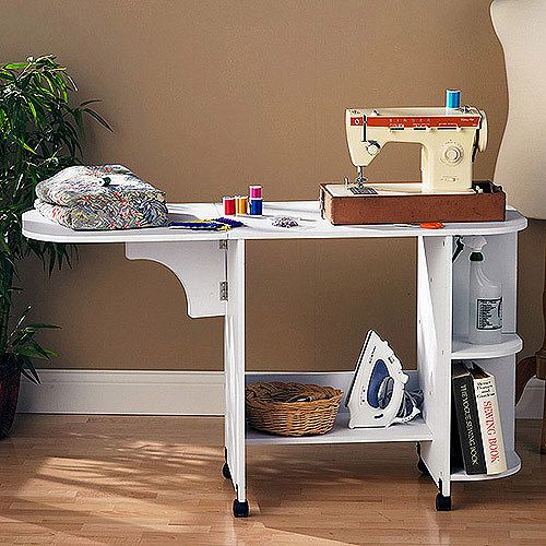 White Sewing Table  this would work with the wheels to put it in closet!!