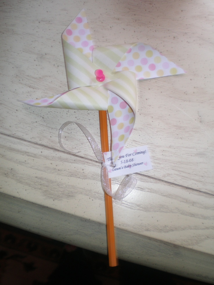 Pinwheels for a spring baby shower.  Simply use a pencil, decorative 2 sided folded paper, and a push pin.