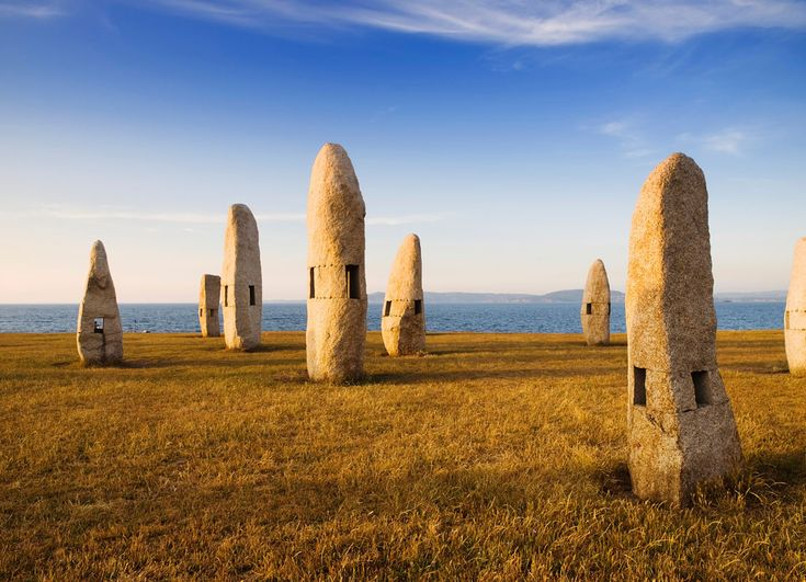 Parque Dos Menhires (La Coruña), Spain. In the surroundings of the Tower of Hercules, is the sculpture park, known as Celtic Park or Garden of Hercules, a natural area of 47 hectares that make up a veritable museum of contemporary art outdoors. Menhir FOR PEACE: