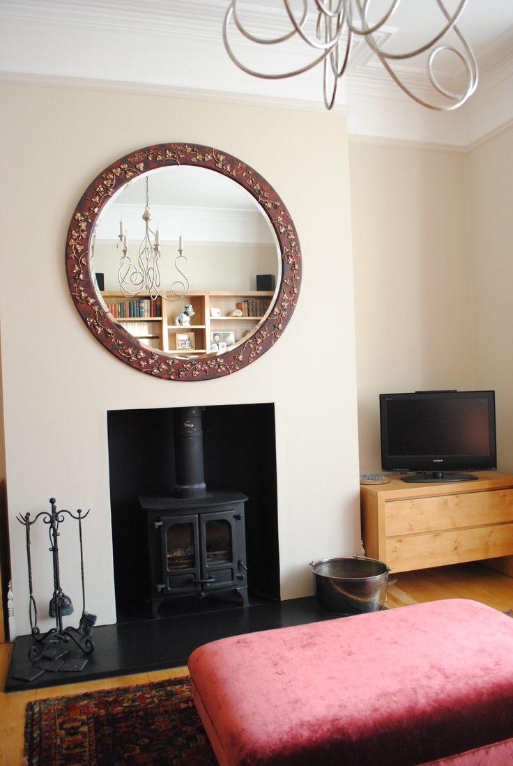 Brighton living room with bespoke Joseph McCarthy mirror, Bella Figura chandelier and footstool in Mulberry velvet.