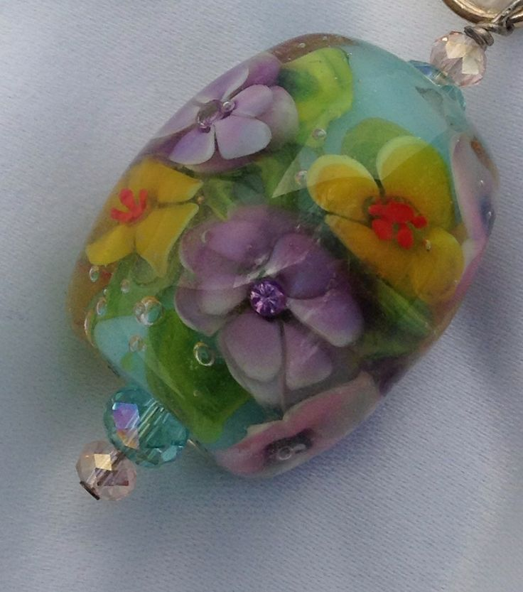 Encased floral with CZ's - a permanent posy