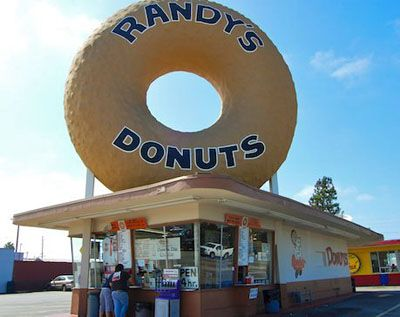 Love donuts? Nothing like being on a road trip or RVing and coming across a funky roadside attraction like this one! (Randy's Donuts in Inglewood, California)