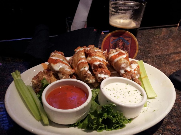 BJ's Restaurant and Brewhouse has the best wings hands down. During happy hour (M-F 3-7 PM & Th-Sun 9-11 PM), you can get them for $5, which is half the regular price. In fact, their mini-pizza's are also $5 during HH.