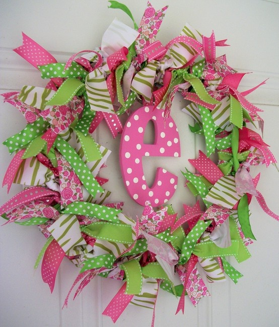 Cute Letter Wreath!!!! Cut peices of cloth into long skinny peices and pin them to a styrofoam wreath and buy a letter and paint it ANY color and hang it in the middle and hang it on your door for EVERYBODY to see!!!