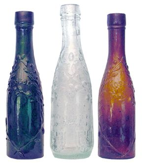 Antique Bottles - Miniatures Left and right are Roses Lime Juice, the full size bottle is 353mm. The centre bottle is embossed Goldberg & Zeffertt, Johannesburg.