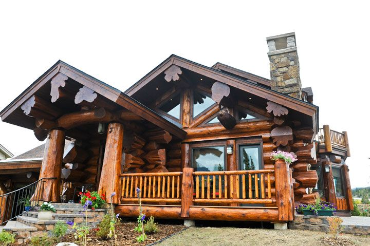 Pioneer Log Homes of BC. If there's a way to fake the big logs, I would want this. Otherwise, no way I would waste the trees for a style.