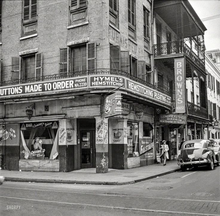 "January 1941. ""Old buildings in New Orleans."" Custom Buttons and ""Sandwiches of All Kind."" Photo by Marion Post Wolcott."