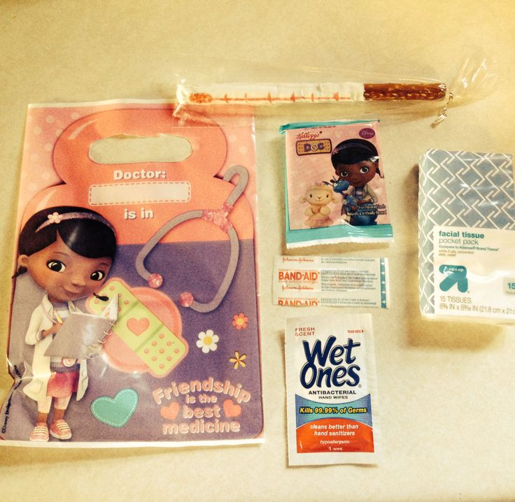 "Doc McStuffins goody bags! Antibacterial wipe, tissue pack, Doc band-aid, Doc fruit snacks and a chocolate pretzel ""thermometer""!"