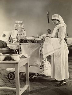 A nurse cleans medical instruments in the WWI American hospital in Neuilly…