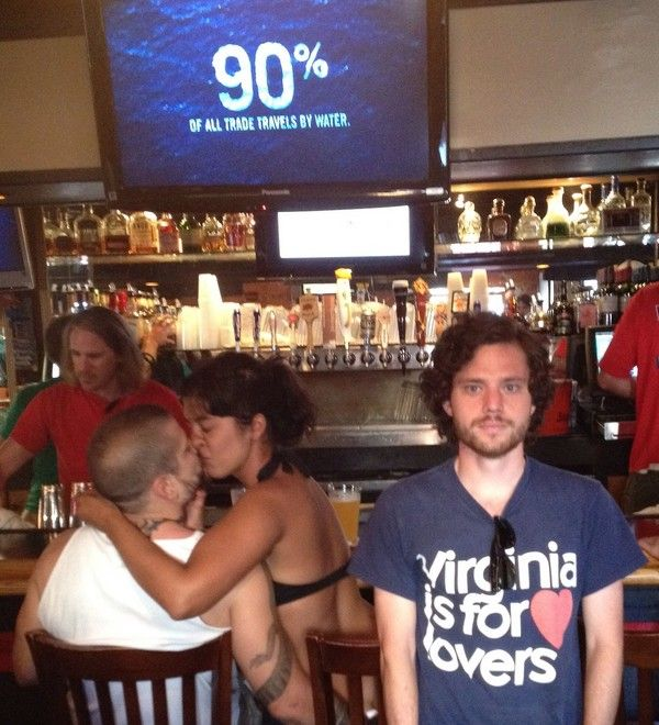 15 Of the Best Pictures of the Dude that Takes Pictures with Couples that Make Out In Public.