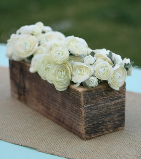 Rectangular wooden flower box with low white and green flowers