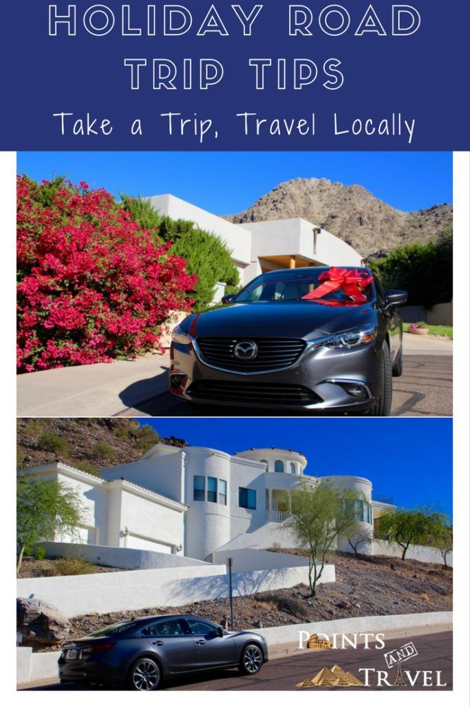 Holiday Road Trip Tips: Take a Trip, Travel Locally, silver Mazda6 with a white house and rock mountain, blue sky, car with a giant red holiday bow