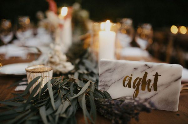 These earthy table runners and metallic candles add to the laid back vibe of this boho wedding. The marble table numbers are a great example that you can incorporate the trendy wedding detail into your big day, no matter the theme!