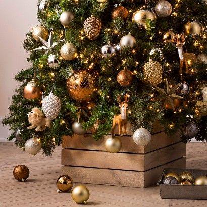 Celebrate in style with the natural elements of gold, bronze, and silver in this Foundry Ornaments Collection. Pinecones in sparkling metallic shades, classic reindeer and bright star ornaments decorate this collection with brilliance and wonder. You'll enjoy a variety of shiny, glittered and satin ball ornaments – perfect for accessorizing your tree.