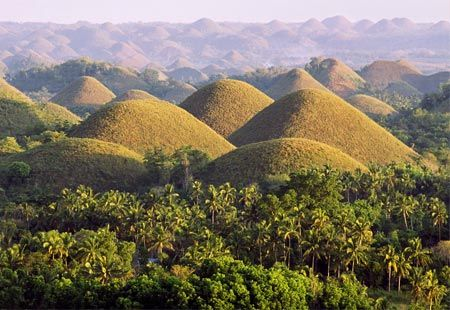 Chocolate Hills from the Philippine island of Bohol. Legend says a defecating giant buffalo formed them after being fed food poisoning by vengeful farmers.