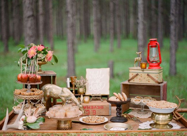 "hmmmm... idk what I think about this? rustic dessert bar  ""A vintage peddler's cart, decorated with whimsical woodland details + eclectic serving vessels, is perfect for displaying an array of fall-inspired desserts like pies + candied apples!"""