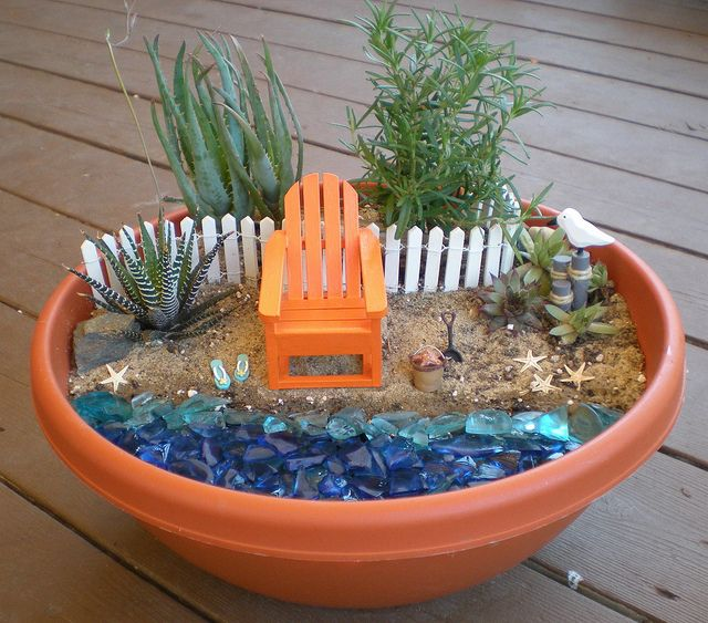 Mini Garden with orange chair, succulents, blue stones like beach