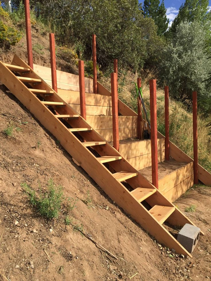 Steep hillside terraces with staircase to be turned into - How to terrace a hillside ...