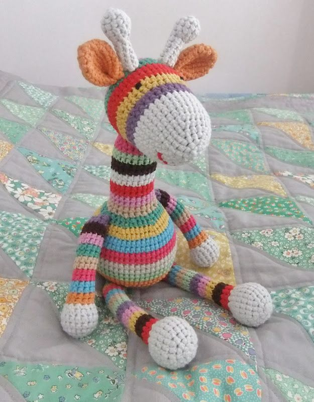 Colourful crochet Giraffe. Do you want to know his name... Buttons!!! By the way have you seen the quilt he's on. It has bunting on and everything!! Mum please note... I want it!