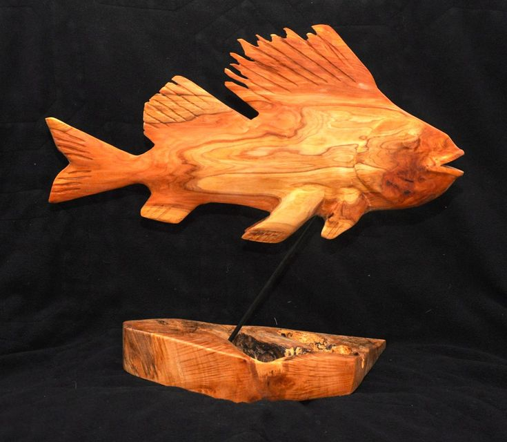 """This rockfish is carved out of red cedar with a spalted maple base.  The fish is about 15"""" long."""