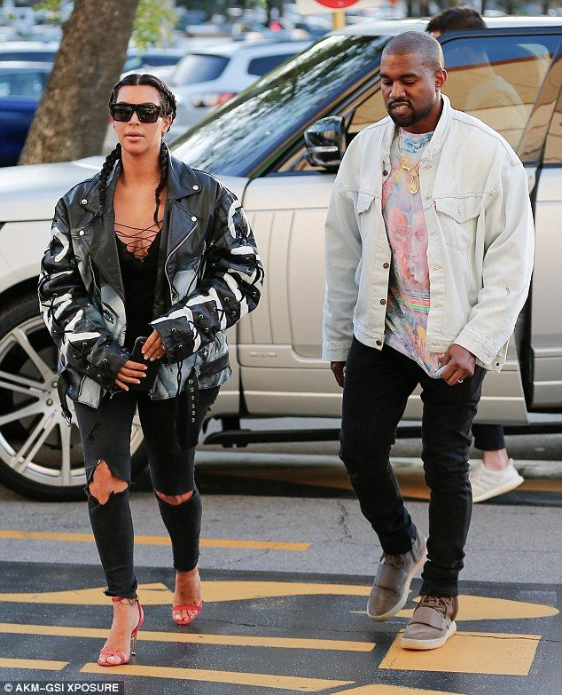 Stylish pair: The rapper and fashion designer wore a white jean jacket and a pair of his Yeezy Boost 750 sneakers