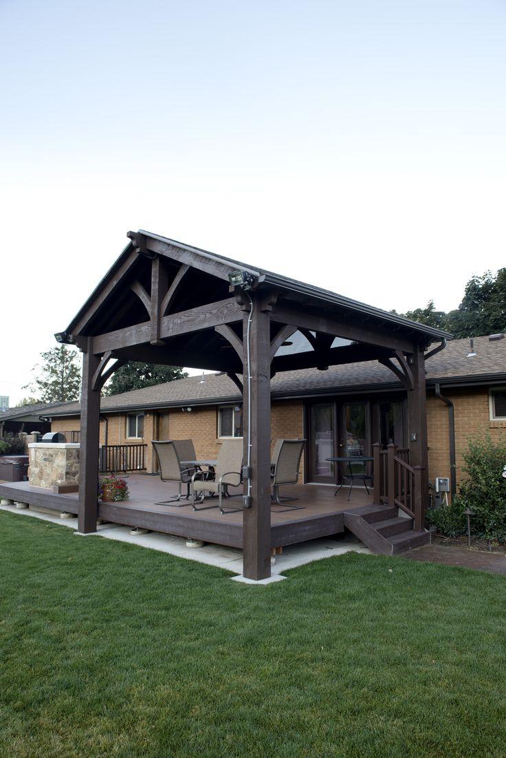 Solid wood timber frame ShadeScape™ DIY pavilion kit installed over backyard deck.
