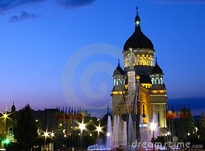 Avram Iancu Square, Cluj-Napoca, Romania at the blue hour. In front we have the statue of Avram Iancu (the leader of romanian revolution from Transylvania 1848-1849 and was sculpted by Ilie Berindei) and an illuminated fountain at his feet, behind lays the Orthodox Cathedral of Cluj, Alba, Crisana and Maramures, built between 1923-1933.